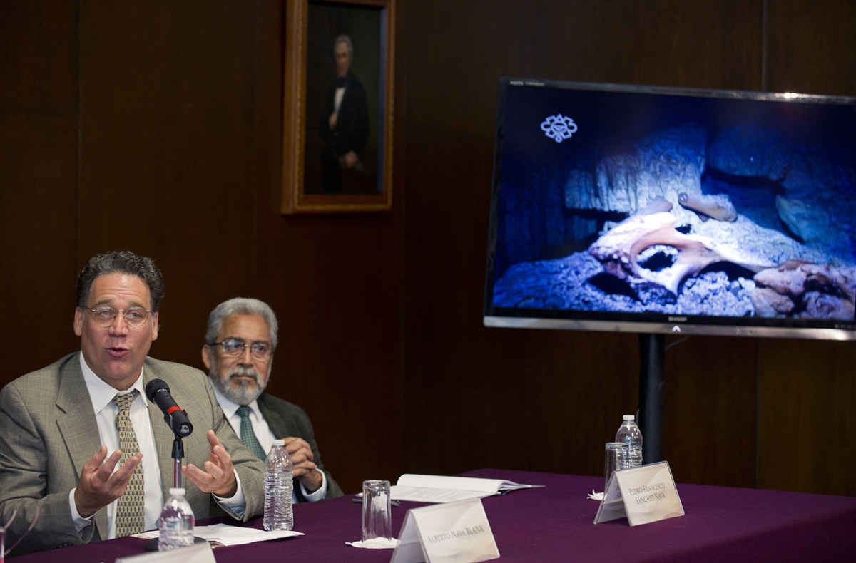 """Scientific diver Alberto Nava Blank (L) and Pedro Francisco Sanchez (R) of the Tulum Speleological Project, offer a press conference at the Anthropology National Museum in Mexico City, on May 15, 2014. A teenage girl who fell into a hole more than 12,000 years ago in Mexico's Yucatan Peninsula is offering new clues about the origins of the first Native Americans, researchers said Thursday. Named """"Naia"""" by scientists, her skeleton is among the oldest known and best preserved in the Americas. New bones discovered in a different cave nearby also date back to 13,000 years ago. (ALFREDO ESTRELLA/AFP/Getty Images)"""