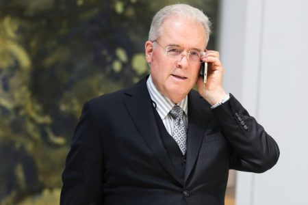 Billionaire Robert Mercer speaks on the phone during the 12th International Conference on Climate Change hosted by The Heartland Institute on March 23, 2017 in Washington, D.C. (Photo by Oliver Contreras/For The Washington Post via Getty Images)