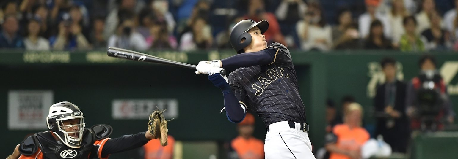 Japan's baseball star Shohei Ohtani hits a double in the seventh inning during the game between Japan and the Netherlands at the Tokyo Dome on November 13, 2016. (KAZUHIRO NOGI/AFP/Getty Images)