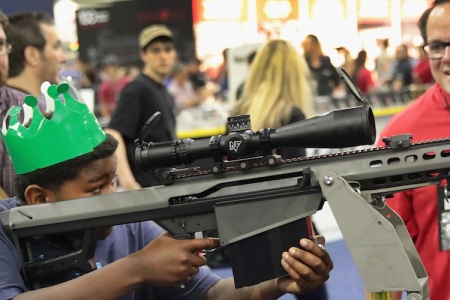 A demonstration at  the National Rifle Association's 146th meet-up. (Photo by Scott Olson/Getty Images)