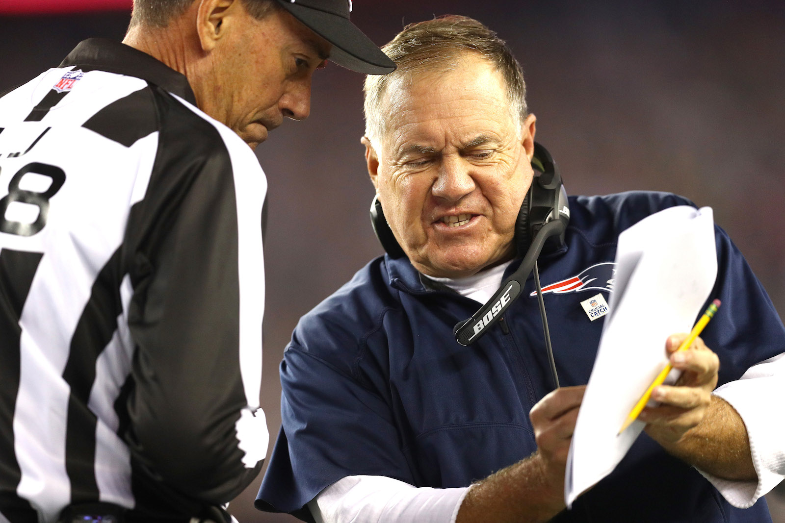 NFL head coach Bill Belichick of the New England Patriots speaks with a referee during a game against the Atlanta Falcons at Gillette Stadium on October 22, 2017. (Maddie Meyer/Getty Images)
