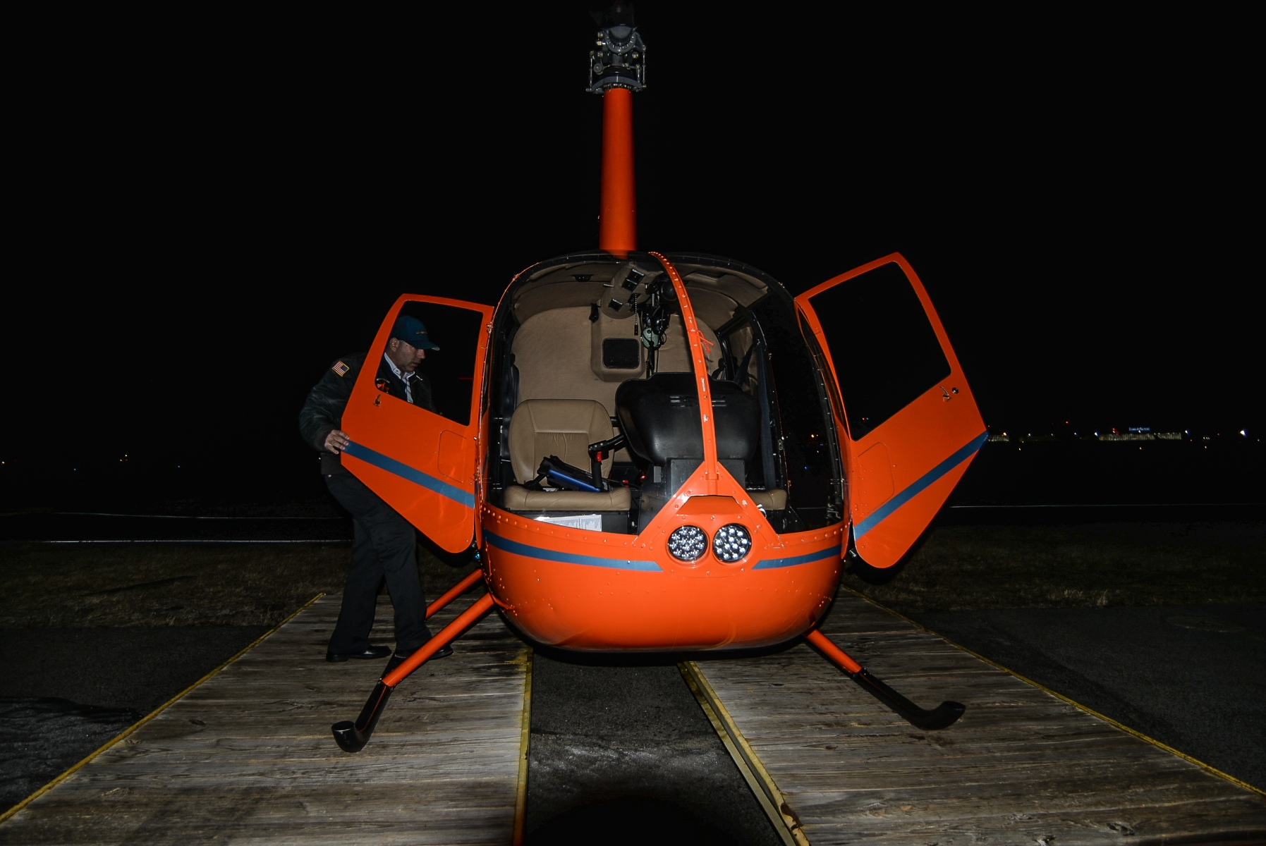 """Anthony Ianni readies the WingsAir """"Pumpkin"""" helicopter for flight. (Diana Crandall)"""