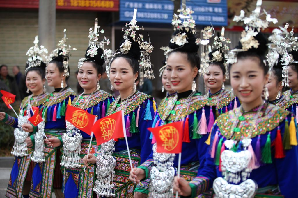 Members of the Dong ethnic minority in traditional costumes parade during their traditional Dong Year festival on December 18, 2017 in Liping, China. The Dong Year is the traditional festival of China's Dong ethnic minority, and it is celebrated during the eleventh lunar month, from the first day to the eleventh day.  (Photo by Qu Honglun/China News Service/VCG via Getty Images)
