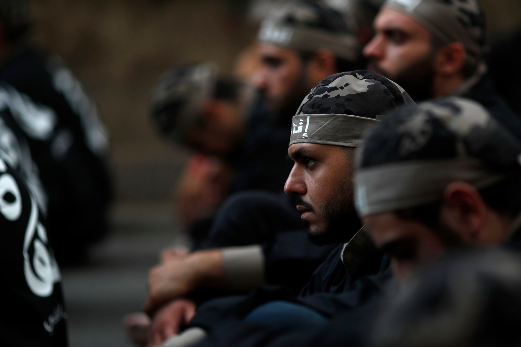 Lebanese Shiite supporters of Hezbollah listen to the story of Imam Hussein, during activities marking the holy day of Ashoura, in southern Beirut, Lebanon, Sunday, Oct. 1, 2017. Ashoura is the annual Shiite Muslim commemoration marking the death of Imam Hussein, the grandson of the Prophet Muhammad, at the Battle of Karbala in present-day Iraq in the 7th century. (AP Photo/Hassan Ammar)
