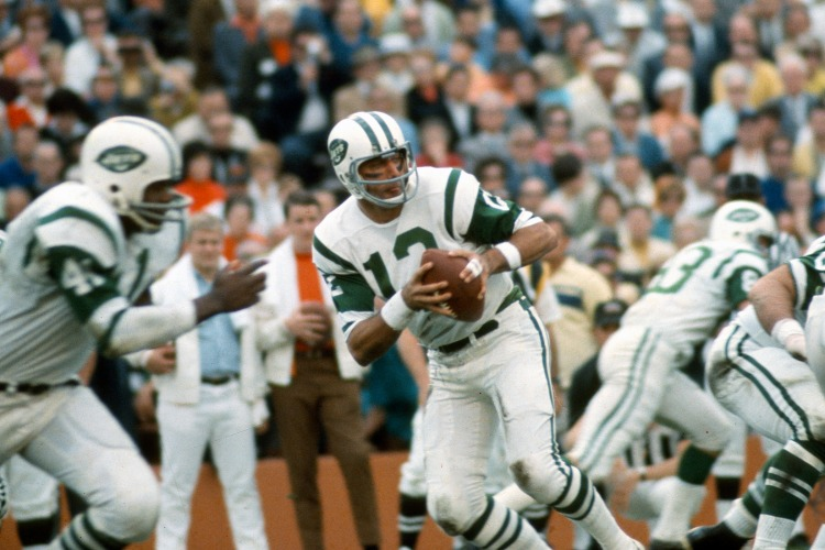 Joe Namath #12 of the New York Jets drops back to pass against the Baltimore Colts during Super Bowl III at the Orange Bowl on January 12, 1969 in Miami, Florida. The Jets defeated the Colts 16-7. (Focus on Sport/Getty Images)
