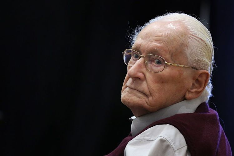 "Defendant and German former SS officer Oskar Groening , 94, dubbed the ""bookkeeper of Auschwitz"", sits on July 1, 2015 at the courtroom at the 'Ritterakademie' venue in Lueneburg, northern Germany ahead of his trial. Groening and a survivor of the Nazi death camp testify in a German court as his historic trial nears a verdict. (Ronny Hartmann/AFP/Getty)"