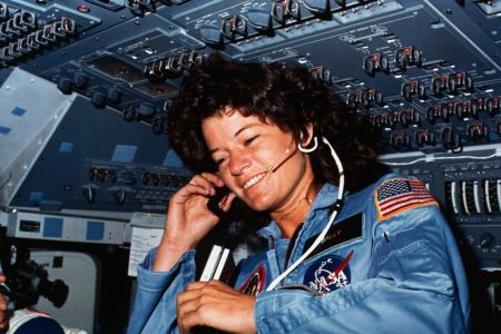 On board Scene-Astronaut Sally K. Ride, STS-7 mission specialist, communicates with ground controllers from the flight deck of the Earth-orbiting Space Shuttle Challenger. Dr. Ride holds a tape recorder. The photograph was taken by one of her four fellow crewmembers with a 35mm camera.