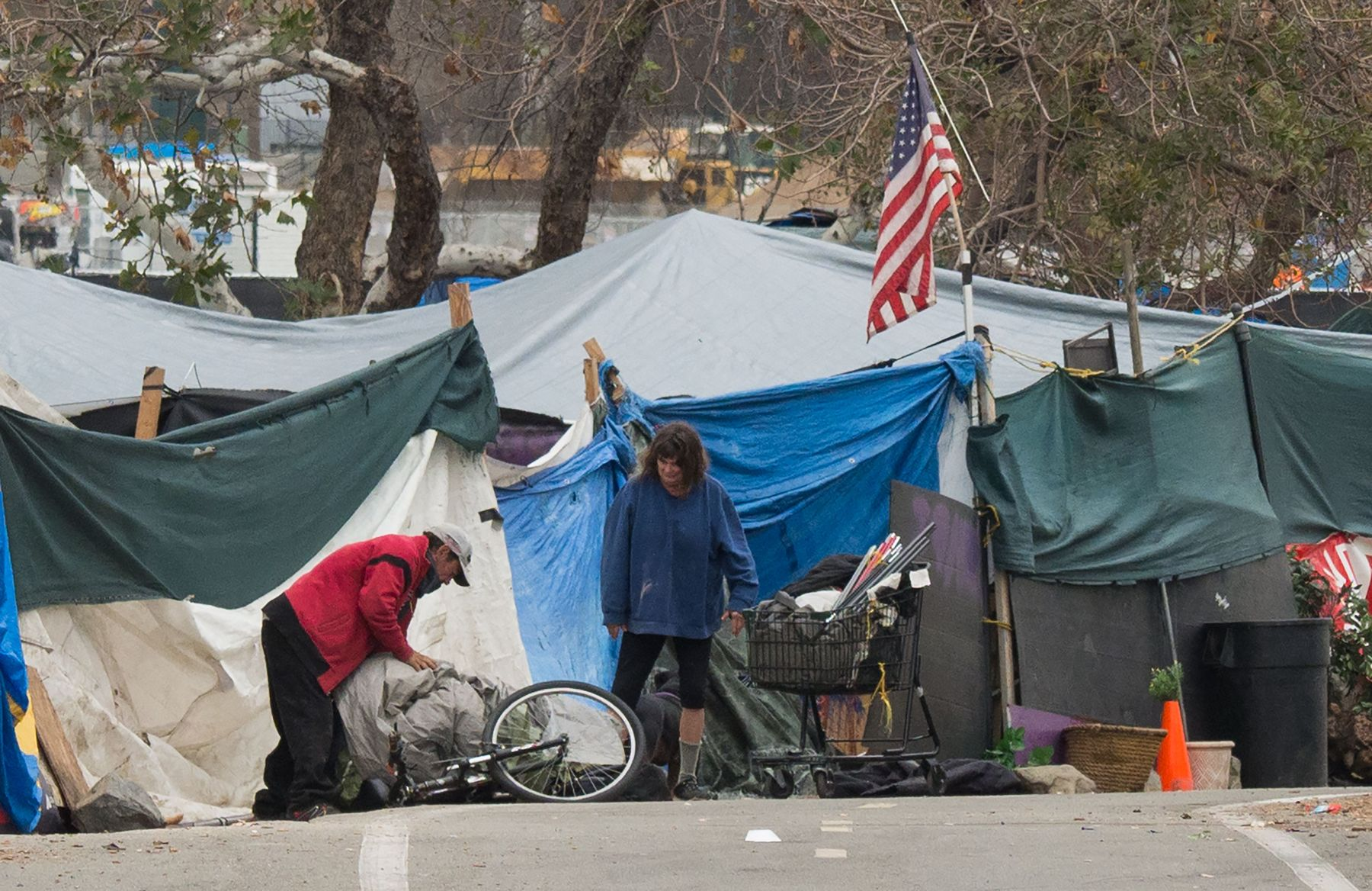 A homeless encampment made of tents and tarps lines the Santa Ana riverbed near Angel Stadium in Anaheim, California, January 25, 2018. (ROBYN BECK/AFP/Getty Images)