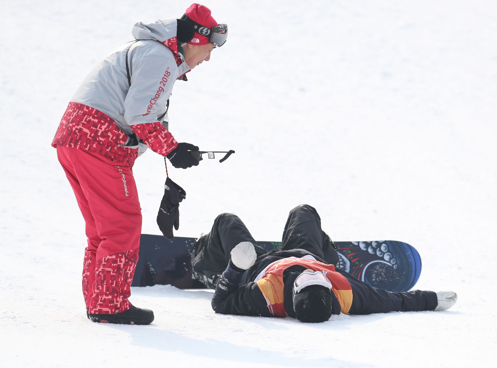 Sweden's Mans Hedberg lies injured after a heavy fall in run 2 of qualification for Men's Snowboard Slopestyle the PyeongChang 2018 Winter Olympic Games in South Korea. (Photo by Mike Egerton/PA Images via Getty Images)