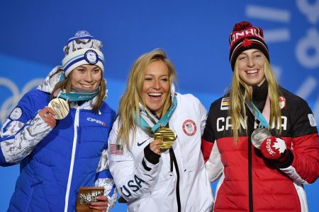 (L-R) Finland's bronze medallist Enni Rukajarvi, USA's gold medallist Jamie Anderson and Canada's silver medallist Laurie Blouin pose on the podium during the medal ceremony for the women's snowboard slopestyle at the Pyeongchang Medals Plaza during the Pyeongchang 2018 Winter Olympic Games in Pyeongchang on February 12, 2018. / AFP PHOTO / Fabrice COFFRINI        (Photo credit should read FABRICE COFFRINI/AFP/Getty Images)