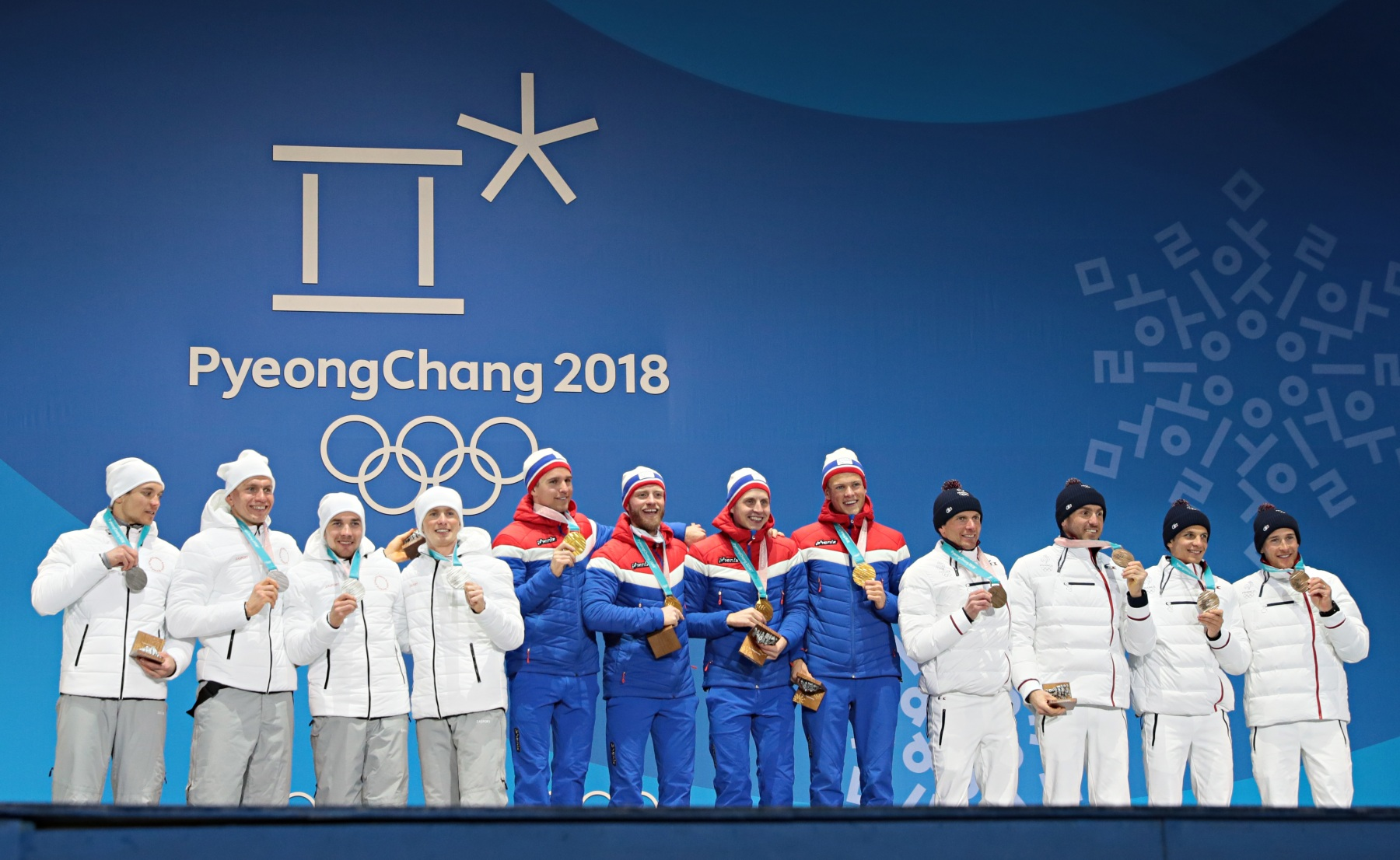 PYEONGCHANG-GUN, SOUTH KOREA - FEBRUARY 18:  Olympic Athlete from Russia wins the silver medal, team Norway wins the gold medal, team France wins the bronze medal of the cross country Men's Relay 4x10km during the Medal Ceremony at Medal Plaza on February 18, 2018 in Pyeongchang-gun, South Korea. (Photo by Laurent Salino/Agence Zoom/Getty Images)