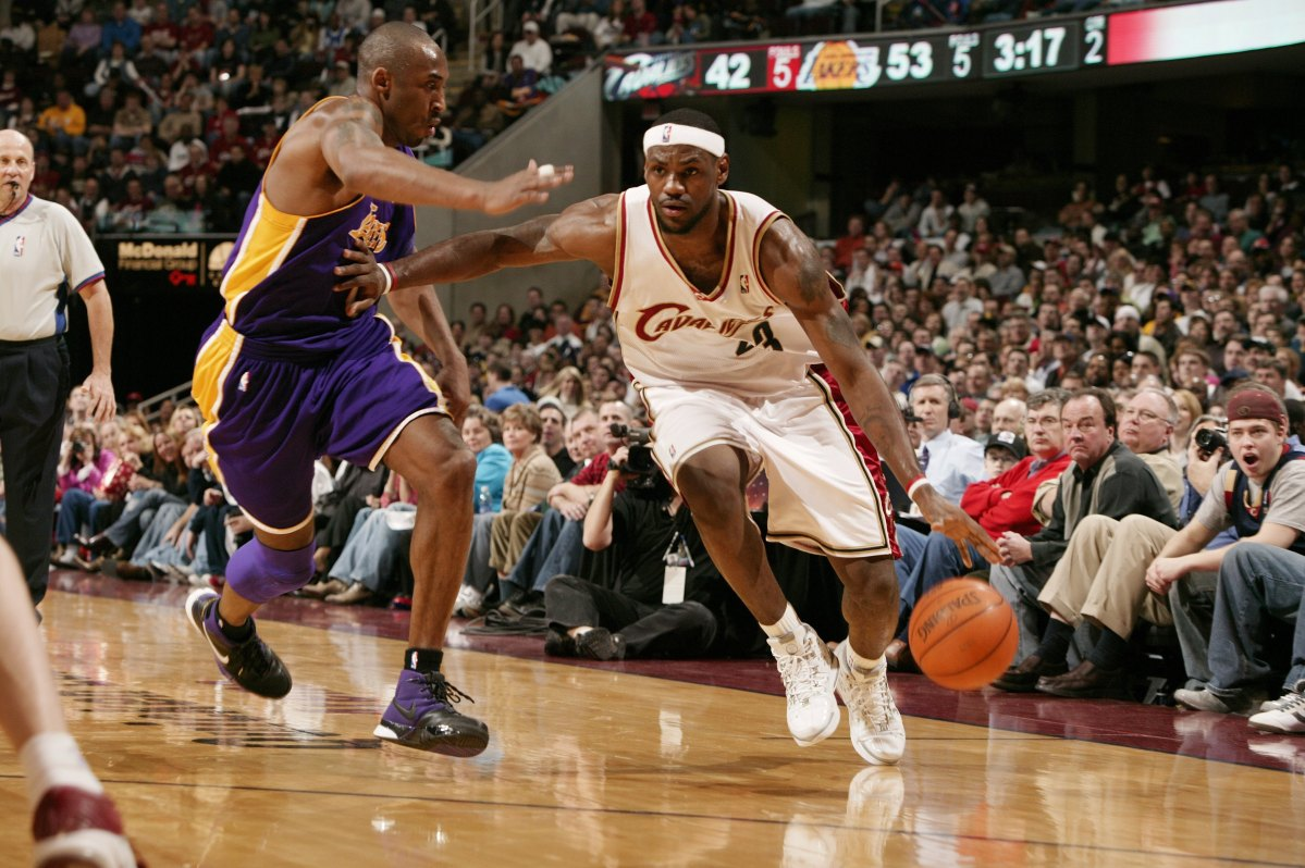 LeBron James #23 of the Cleveland Cavaliers drives to the basket against Kobe Bryant #8 of the Los Angeles Lakers on March 19, 2006 at the Quicken Loans Arena in Cleveland, Ohio.  (Garrett W. Ellwood/NBAE via Getty Images)