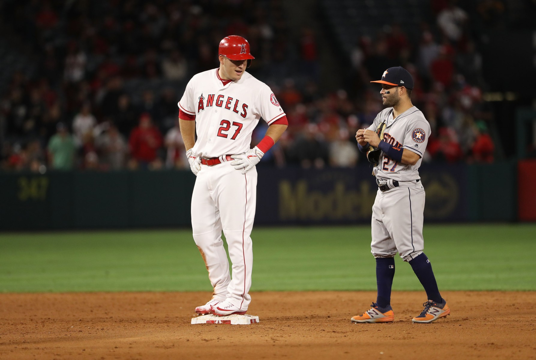 Mike Trout #27 of the Los Angeles Angels of Anaheim talks to Jose Altuve #27 of the Houston Astros during the ninth inning of their MLB game at Angel Stadium of Anaheim on May 5, 2017 in Anaheim, California. The Astros defeated the Angels 7-6 in the tenth inning.  (Photo by Victor Decolongon/Getty Images)