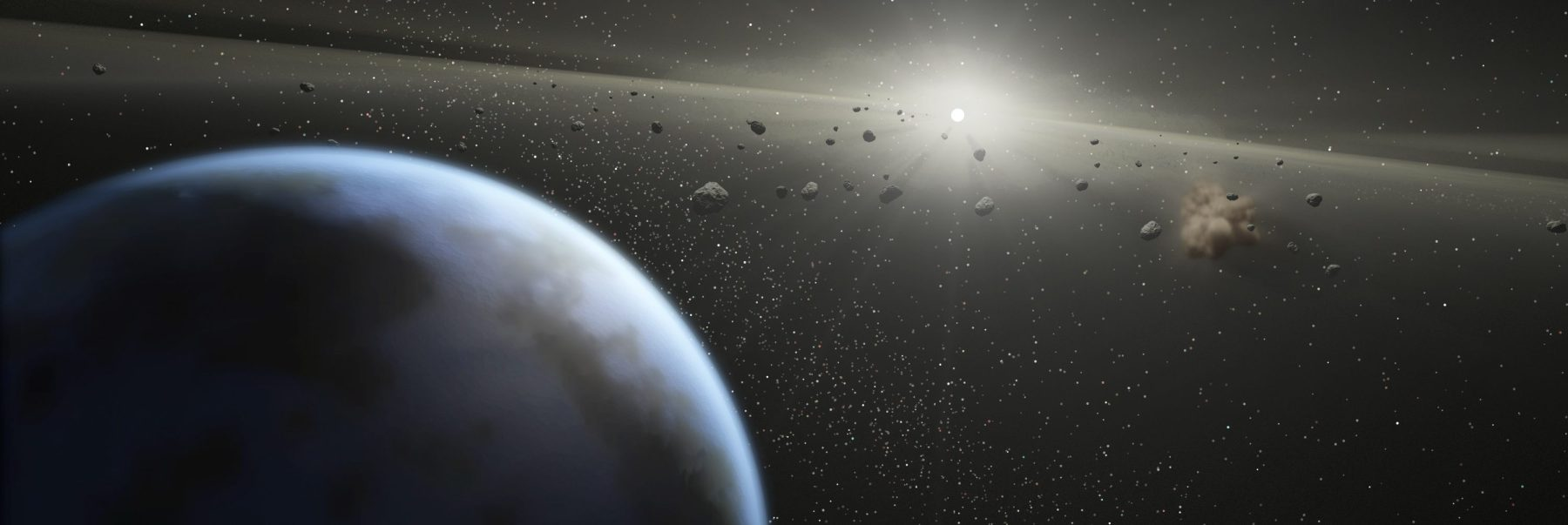 An artists impression showing an asteroid belt around a star similar in size to the sun.  PHOTOGRAPH BY NASA / Barcroft Media /Barcoft Media via Getty Images