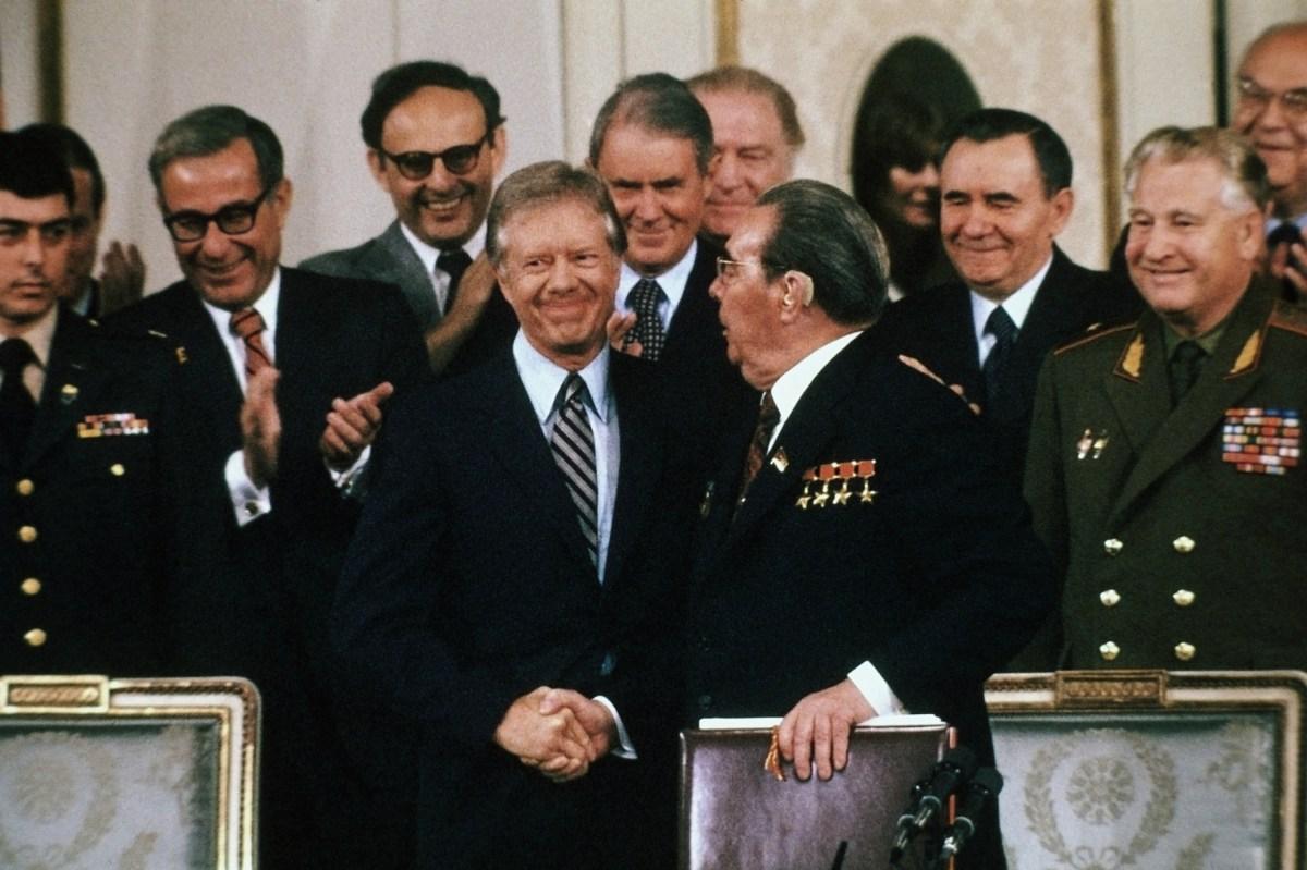 U. S. President Jimmy Carter and Soviet Premier Leonid Brezhnev shake hands after signing the SALT II Treaty in Vienna. (Getty)