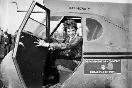 Pilot Amelia Earhart poses for a portrait in and airplane in circa 1936. (Library of Congress/Getty Images)