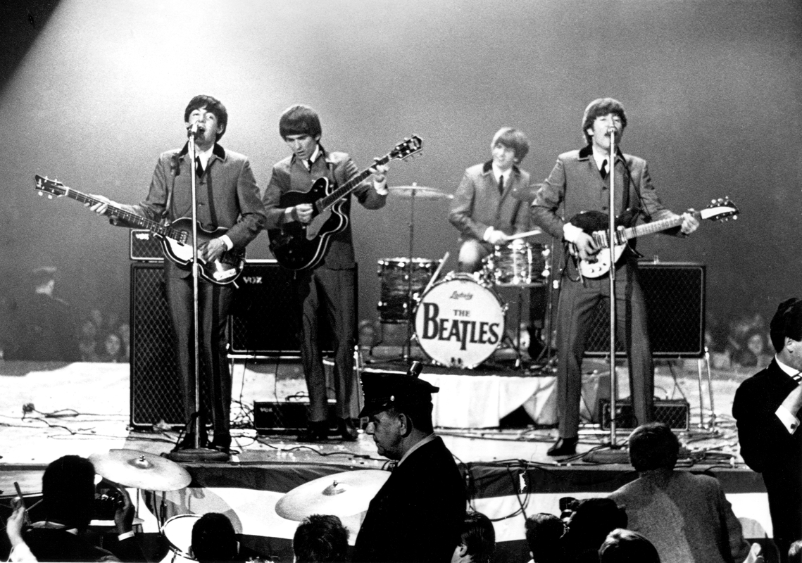 The Beatles perform onstage at the Washington Coliseum on February 11, 1964 in Washington, D.C.   (Photo by Michael Ochs Archives/Getty Images)