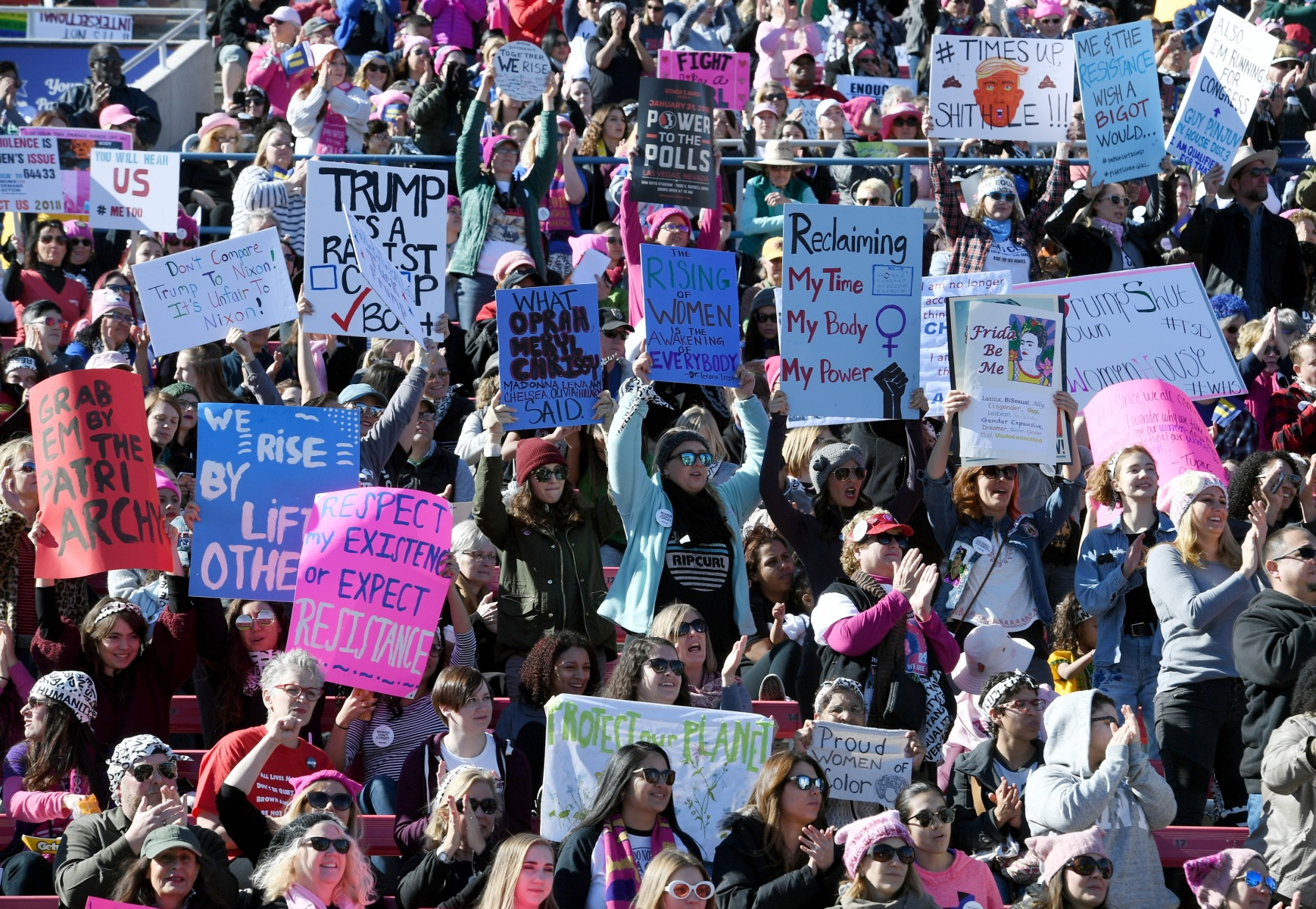"Attendees hold signs during the Women's March ""Power to the Polls"" voter registration tour launch at Sam Boyd Stadium on January 21, 2018 in Las Vegas, Nevada. Demonstrators across the nation gathered over the weekend, one year after the historic Women's March on Washington, D.C., to protest President Donald Trump's administration and to raise awareness for women's issues.  (Ethan Miller/Getty Images)"
