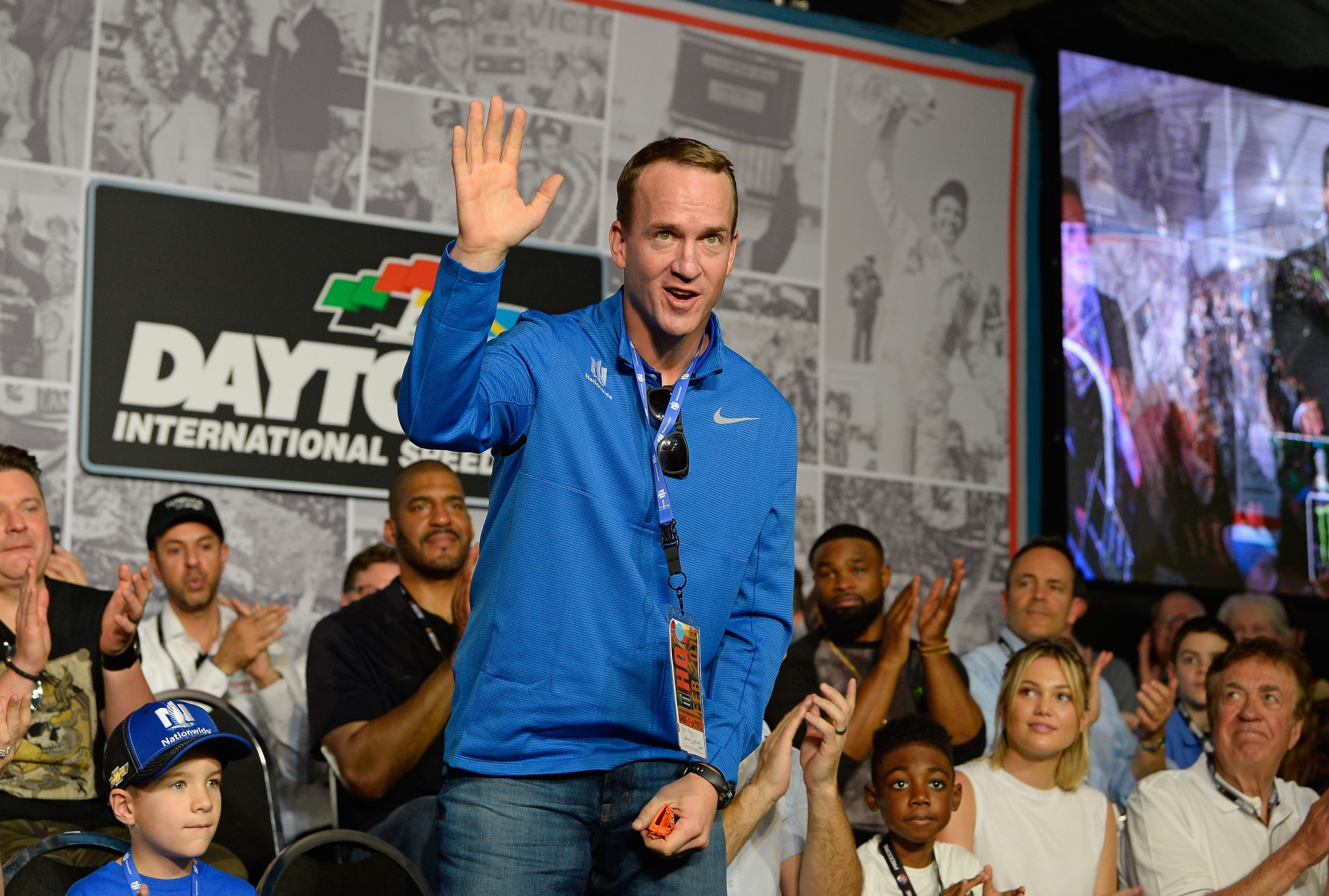 Peyton Manning waves to the crowd during the drivers meeting for the Monster Energy NASCAR Cup Series 60th Annual Daytona 500 at Daytona International Speedway on February 18, 2018 in Daytona Beach, Florida.  (Photo by Robert Laberge/Getty Images)