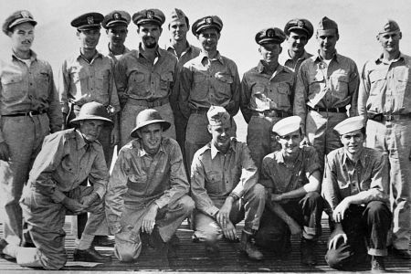 A portrait of the officers of the USS Finback and some U.S. Navy pilots and crew rescued by the Finback. Kneeling second from the left is Ensign George Bush, whose bomber was shot down by the Japanese near the Bonin Islands. September 1944. | Location: aboard the USS Finback, on the Pacific Ocean. (Photo by © CORBIS/Corbis via Getty Images)