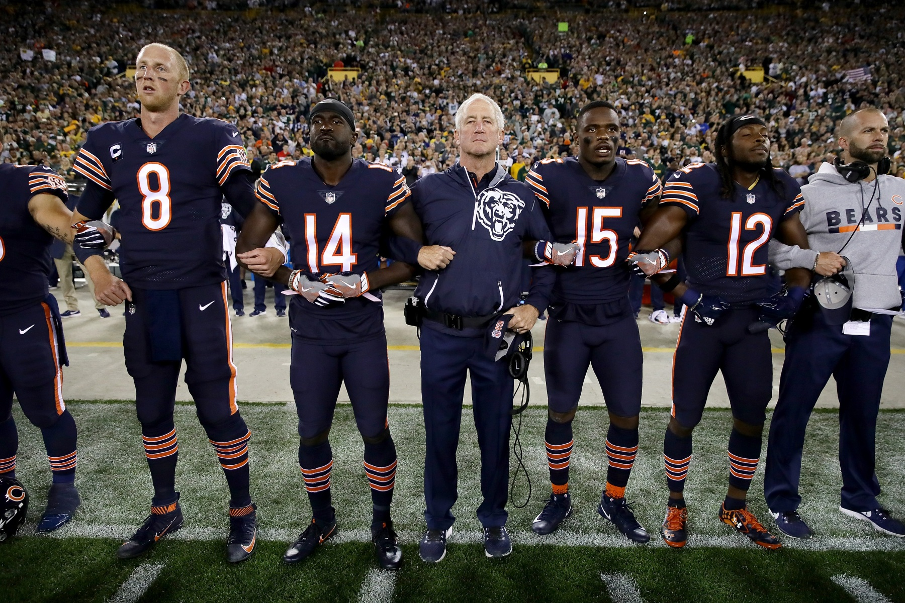 Head coach John Fox of the Chicago Bears links arms with players during the singing of the national anthem before the game against the Green Bay Packers at Lambeau Field on September 28, 2017 in Green Bay, Wisconsin. (Jonathan Daniel/Getty Images)