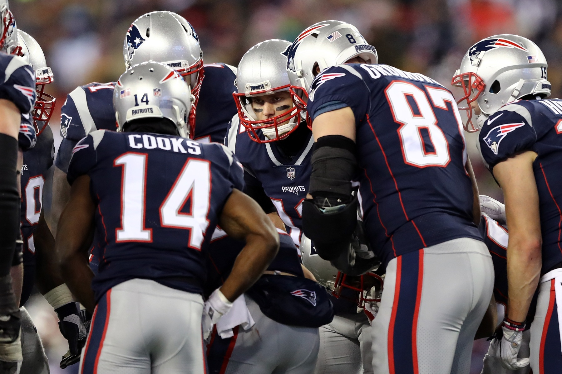 Tom Brady #12 of the New England Patriots reacts in the huddle with Brandin Cooks #14 and Rob Gronkowski #87 during the fourth quarter  in the AFC Divisional Playoff game against the Tennessee Titans at Gillette Stadium on January 13, 2018 in Foxborough, Massachusetts.  (Photo by Elsa/Getty Images)