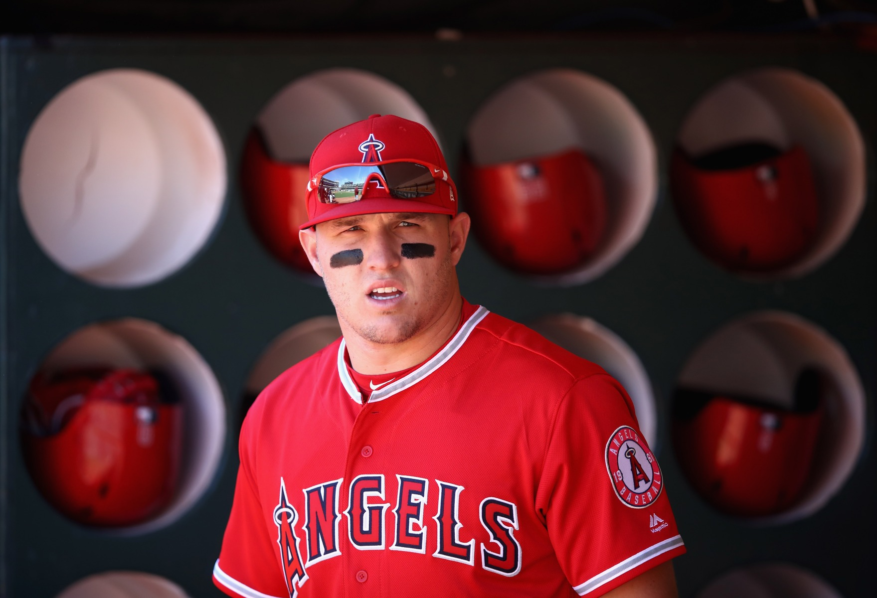 Mike Trout #27 of the Los Angeles Angels stands in the dugout before their game against the Oakland Athletics at Oakland Alameda Coliseum on March 29, 2018 in Oakland, California.  (Photo by Ezra Shaw/Getty Images)