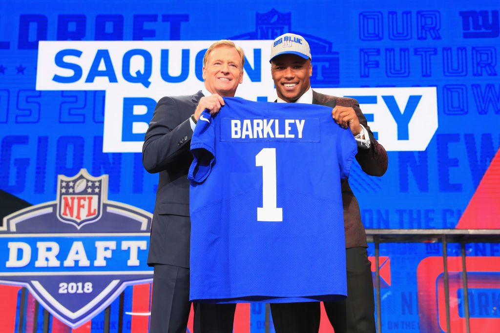 Saquon Barkley of Penn State poses with NFL Commissioner Roger Goodell after being picked #2 overall by the New York Giants during the first round of the 2018 NFL Draft at AT&T Stadium on April 26, 2018 in Arlington, Texas.  (Photo by Tom Pennington/Getty Images)