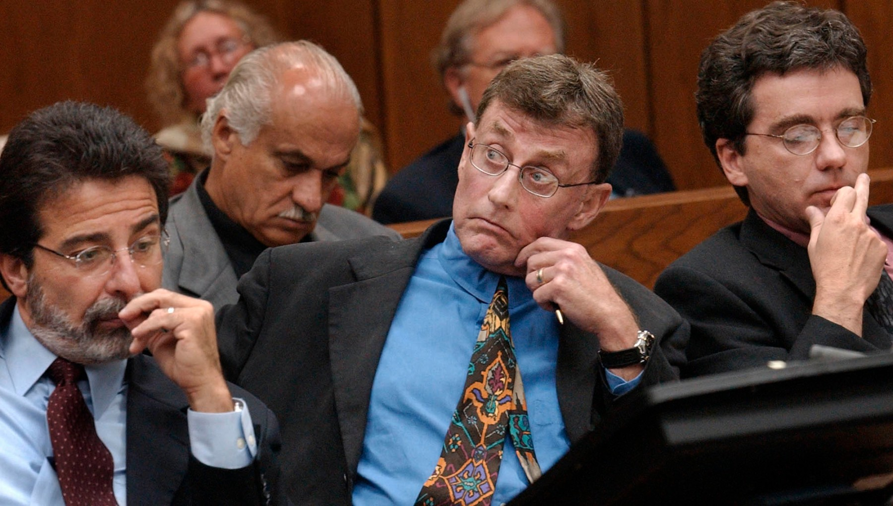 Michael Peterson watches as prosecutor David Saacks, not pictured, argues why gay pornography and e-mail soliciting sex with another man taken from  Peterson's home computer should be presented to the jury during Peterson's murder trial, Thursday Aug. 7, 2003, in Durham, N.C. (AP Photo/Chuck Liddy, Pool)