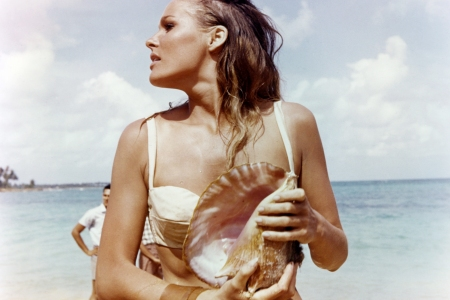 Ursula Andress, Swedish actress, wearing a white bikini and holding a conch shell in a publicity still issued for the film, 'Dr No', 1962. The James Bond film, directed by  Terence Young (1915-1994), starred Andress as 'Honey Ryder'. (Photo by Silver Screen Collection/Getty Images)  (Photo by Silver Screen Collection/Getty Images)