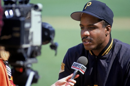 Barry Bonds #24 of the Pittsburgh Pirates talks to the media prior to a game against the Chicago Cubs in 1990 at Wrigley Field in Chicago.  (Jonathan Daniel/Getty Images)