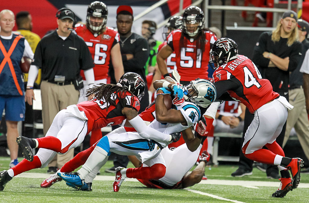 Carolina Panthers running back Fozzy Whittaker (43) is tackled before getting a first down during the first quarter of the NFL game between the Carolina Panthers and the Atlanta Falcons. Atlanta upsets Carolina 20-13 at the Georgia Dome in Atlanta, GA. (Photos by Frank Mattia/Icon Sportswire) (Photo by Frank Mattia/Icon Sportswire/Corbis via Getty Images)