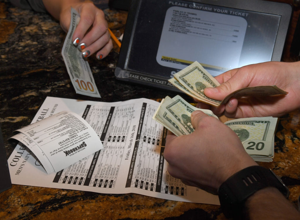 Jake Sindberg of Wisconsin makes bets during a viewing party for the NCAA Men's College Basketball Tournament inside the 25,000-square-foot Race & Sports SuperBook at the Westgate Las Vegas Resort & Casino which features 4,488-square-feet of HD video screens on March 15, 2018 in Las Vegas, Nevada.  (Photo by Ethan Miller/Getty Images)