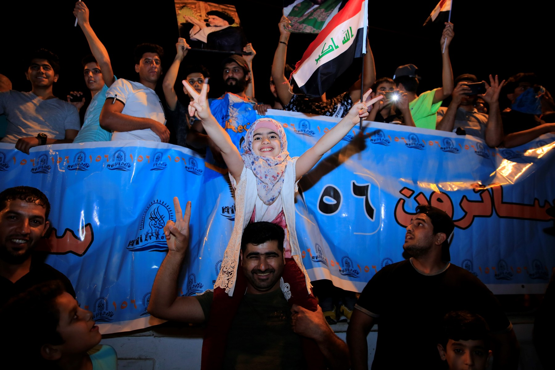 Supporters of Iraqi Shiite cleric Moqtada al-Sadr celebrate the results of the parliamentary election at the Tahrir Square, Baghdad, Iraq.  (Murtadha Sudani/Anadolu Agency/Getty Images)