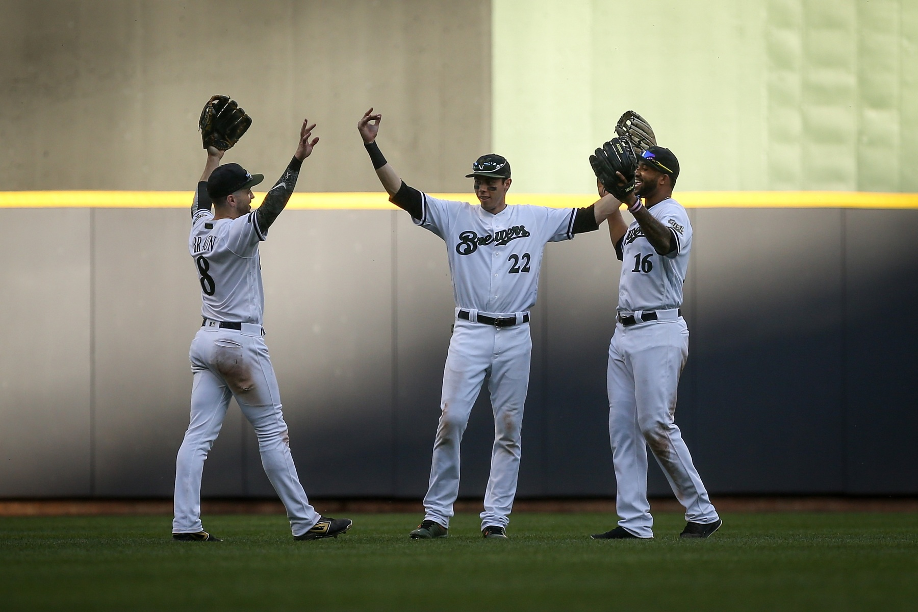 Ryan Braun #8, Christian Yelich #22 and Domingo Santana #16 of the Milwaukee Brewers celebrate after beating the New York Mets 17-6 at Miller Park on May 26, 2018 in Milwaukee, Wisconsin. (Photo by Dylan Buell/Getty Images)
