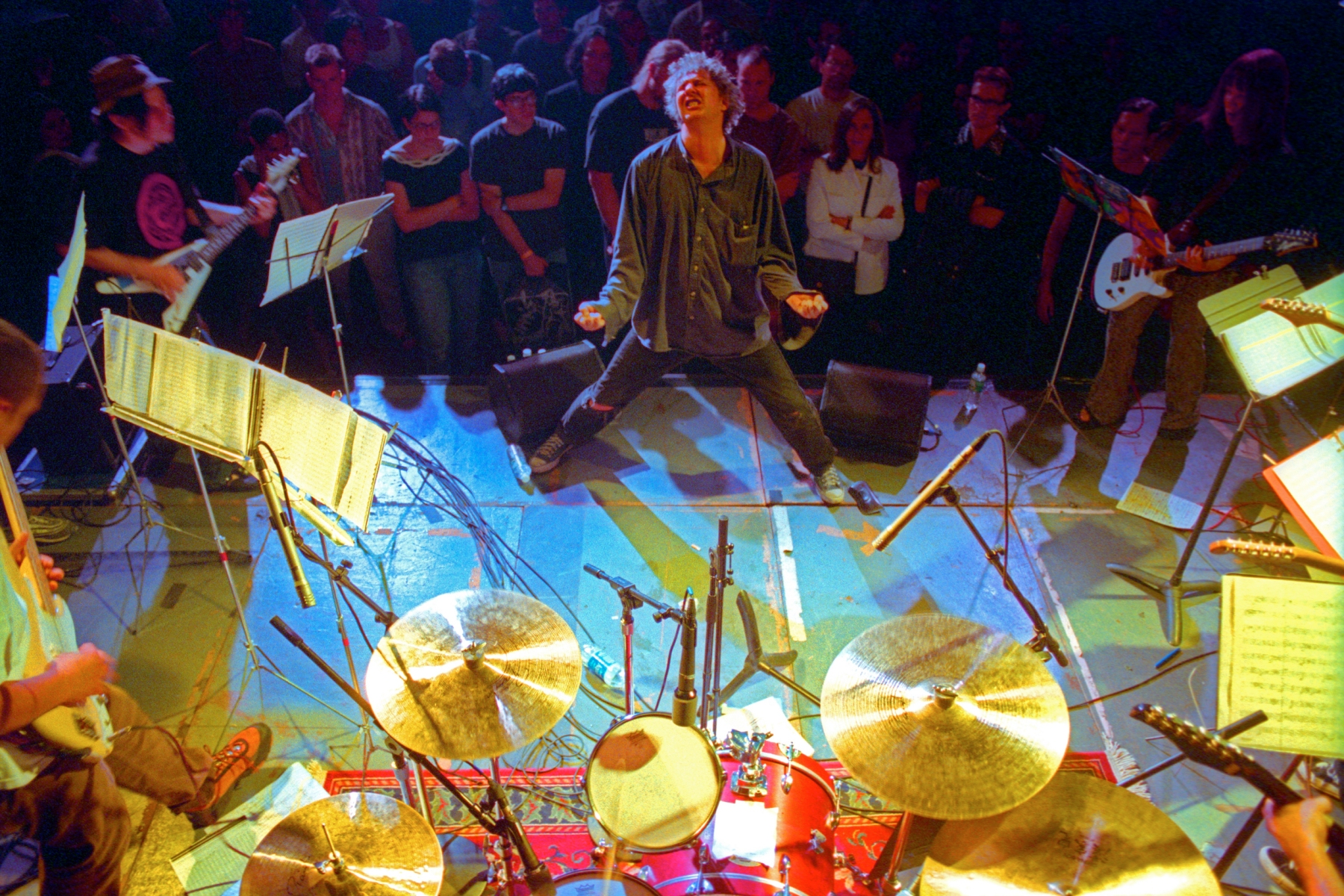Glenn Branca conducting his ensemble at the Anchorage in Brookyn on Thursday night, July 20, 2000.(Hiroyuki Ito/Getty Images)