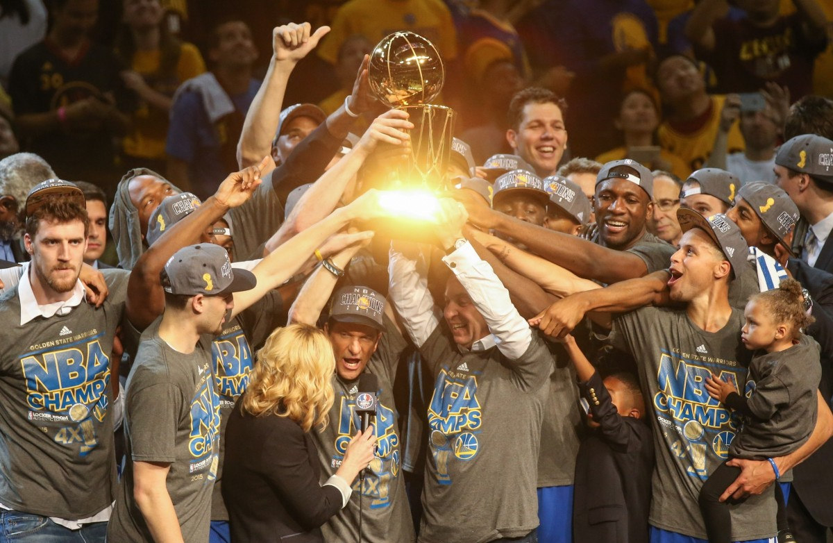 Golden State Warriors players celebrate with Larry O'Brien Championship Trophy after winning Game Six of the 2015 NBA Finals against the Cleveland Cavaliers in Cleveland, Ohio, USA, on June 16, 2015, starting a run of two titles and three consecutive Finals. (Cem Ozdel/Anadolu Agency/Getty Images)