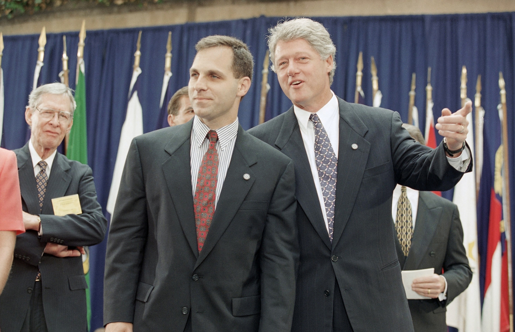 President Bill Clinton talks to FBI Director Louis Freeh during Freeh's swearing ceremony as director at FBI Headquarters in Washington on Sept. 1, 1993. (AP Photo/Wilfredo Lee)