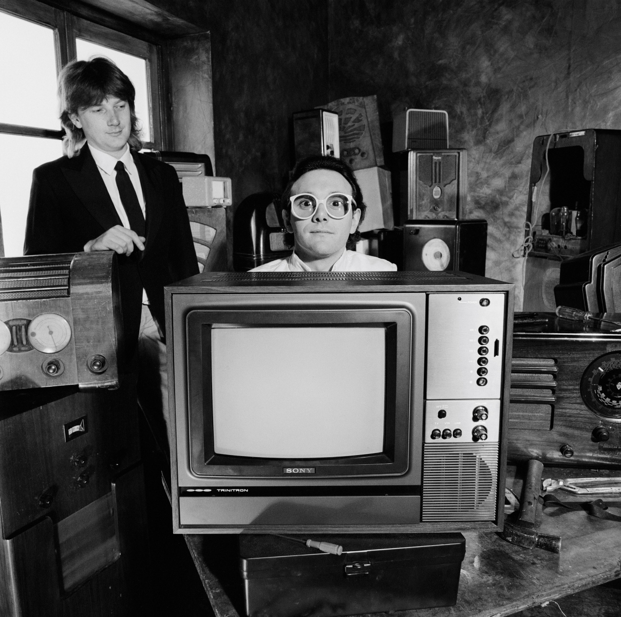 Geoff Downes (left) and Trevor Horn (right) from the group Buggles pose together with various radios and a television in London in June 1979. (Fin Costello/Redferns)