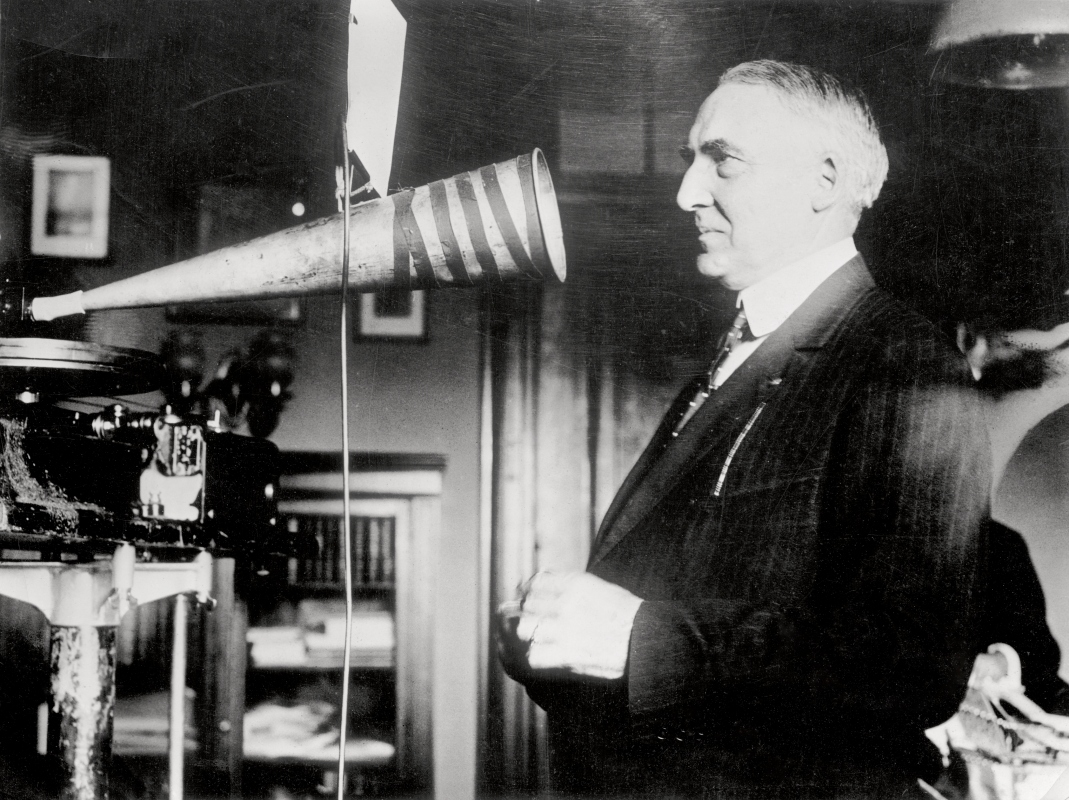 Senator Warren Harding, campaigning in 1920, making a phonograph record of a speech in his office. (Getty)