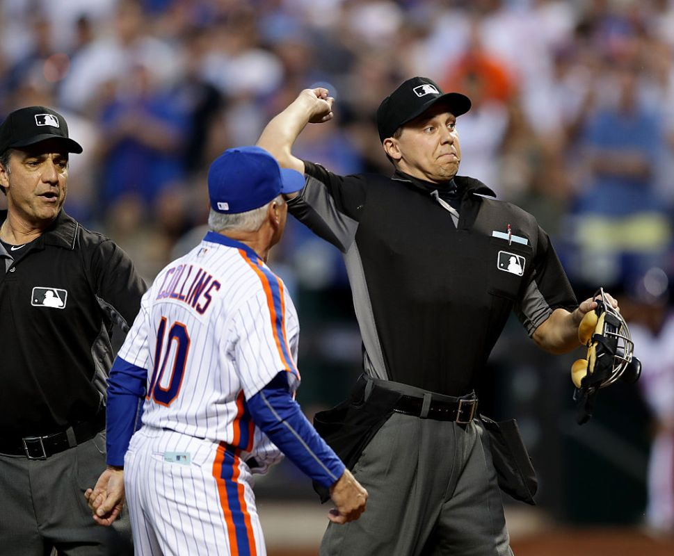 Home plate umpire Adam Hamari throws out manager Terry Collins #10 of the New York Mets after Collins argued the call of starting pitcher Noah Syndergaard getting ejected in the third inning at Citi Field on May 28, 2016 in the Flushing neighborhood of the Queens borough of New York City.  (Photo by Elsa/Getty Images)