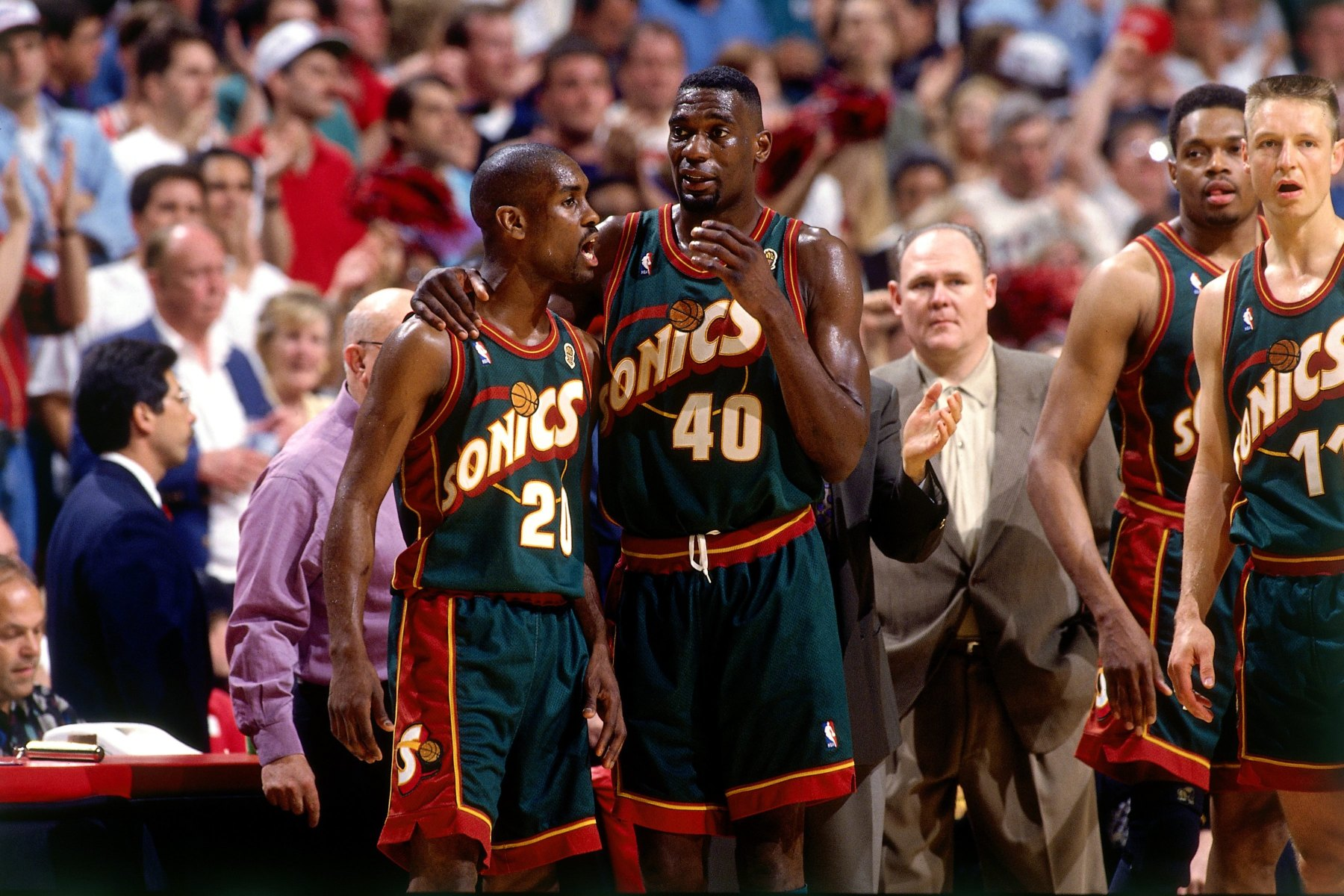Shawn Kemp #40 and Gary Payton #20 of the Seattle SuperSonics discuss strategy during Game Six of the 1996 NBA Finals against the Chicago Bulls at the United Center on June 16, 1996 in Chicago Iillinois.  The Bulls won 87-75.  (Andrew D. Bernstein/NBAE via Getty Images)