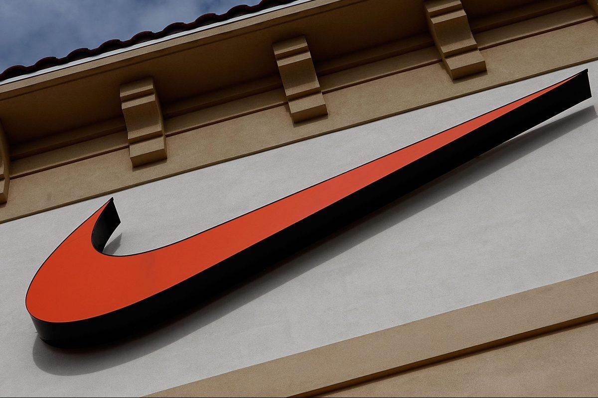 An orange Nike Swoosh logo on a Nike Factory store