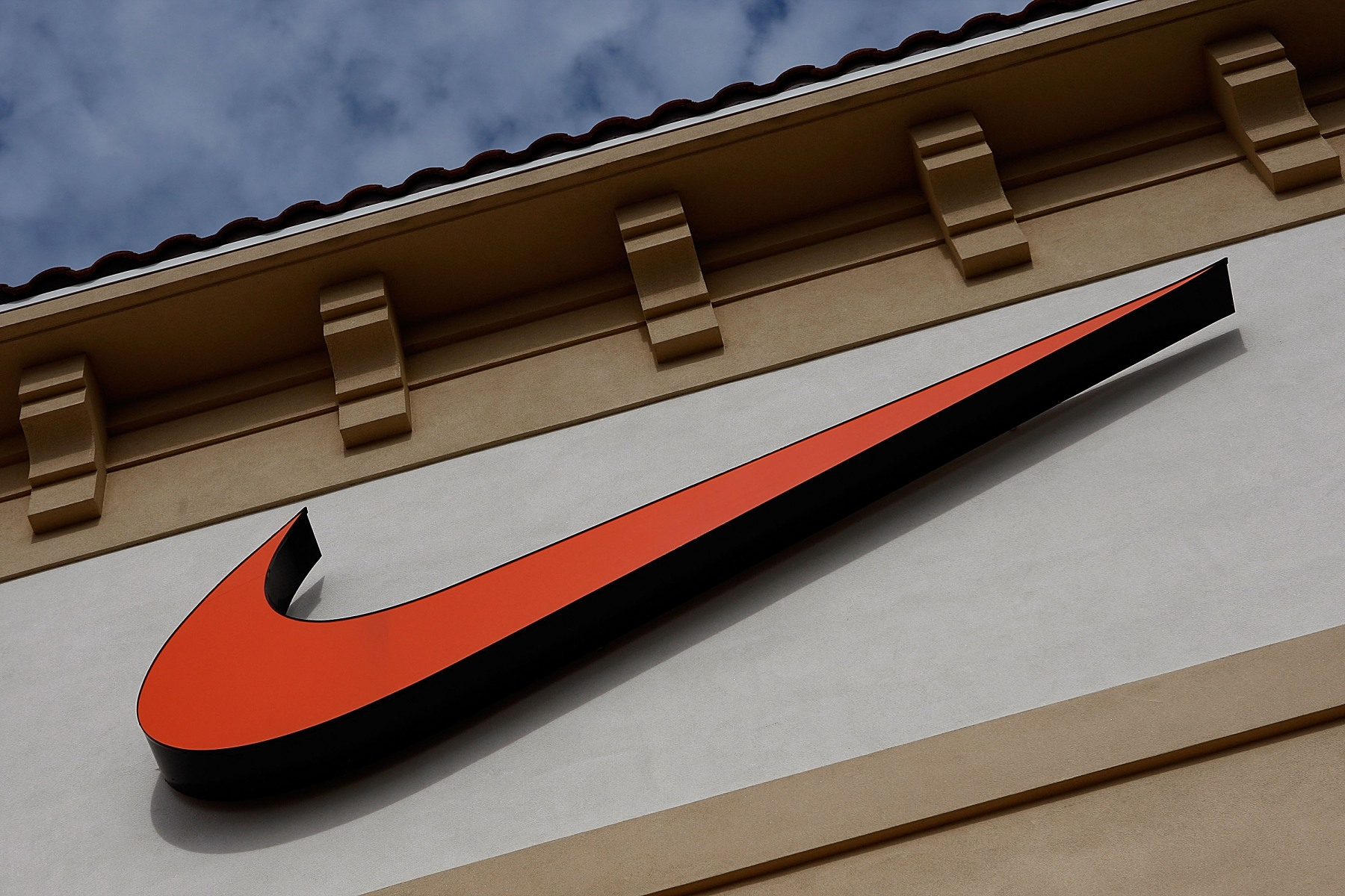 """""""Swoosh"""" logo is seen on a Nike factory store on December 12, 2009 in Orlando, Florida. (Getty Images)"""