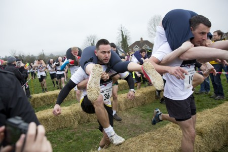 "Competitors take part in the 2018 Wife Carrying Race in Dorking, Surrey, England on April 8, 2018."" (Isabel Infantes/Anadolu Agency/Getty Images)"