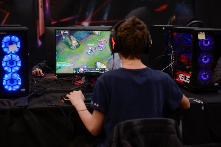 "Gamer plays ""League of Legends"" video game during the Torino Comics' fair in Italy. (Nicolò Campo/LightRocket via Getty Images)"