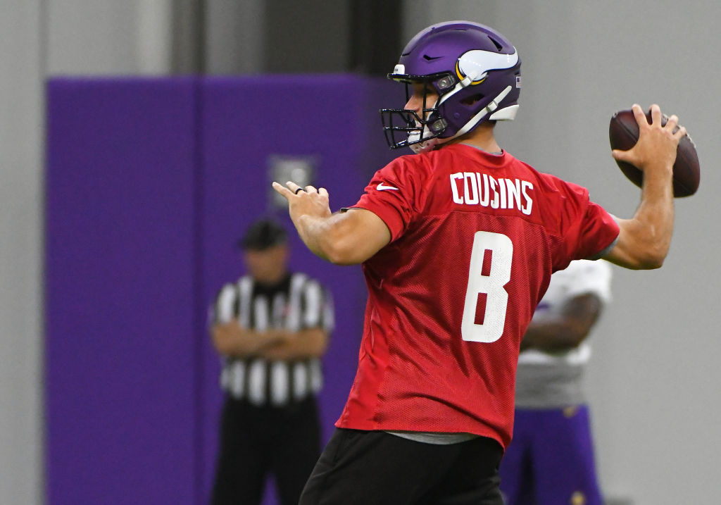 Minnesota Vikings quarterback Kirk Cousins (8) makes a pass during Optional Team Activities on May 30, 2018 at Twin Cities Orthopedics Performance Center in Eagan, MN.(Photo by Nick Wosika/Icon Sportswire via Getty Images)