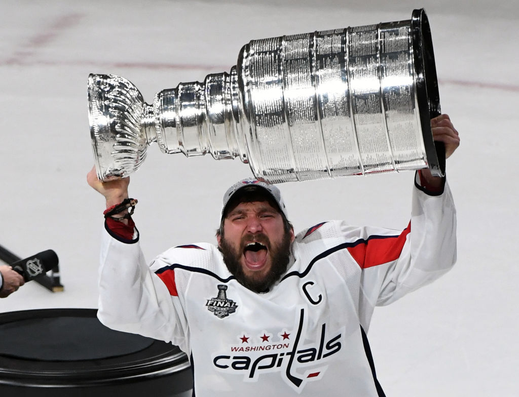 Alex Ovechkin #8 of the Washington Capitals hoists the Stanley Cup after the team's 4-3 win over the Vegas Golden Knights in Game Five of the 2018 NHL Stanley Cup Final at T-Mobile Arena on June 7, 2018 in Las Vegas, Nevada.  (Photo by Ethan Miller/Getty Images)