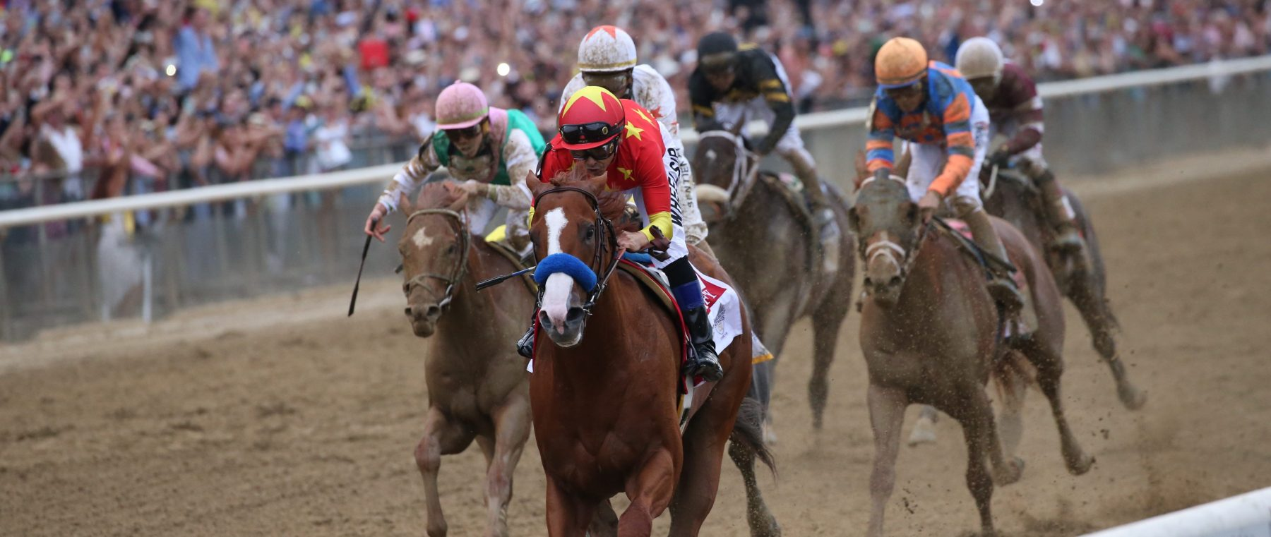 Justify with Mike Smith up wins the Belmont Stakes and Triple Crown for trainer Bob Baffert at Belmont Park Racetrack on June 09, 2018 in Elmont, New York (Photo by Horsephotos/Getty Images)