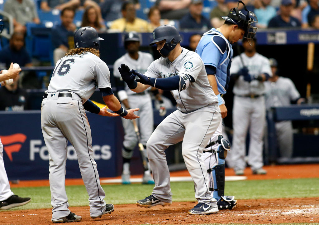 Mike Zunino #3 of the Seattle Mariners celebrates with teammate Ben Gamel in front of catcher Wilson Ramos #40 of the Tampa Bay Rays after scoring off of his two-run home run during the sixth inning of a game on June 10, 2018 at Tropicana Field in St. Petersburg, Florida.  (Photo by Brian Blanco/Getty Images)